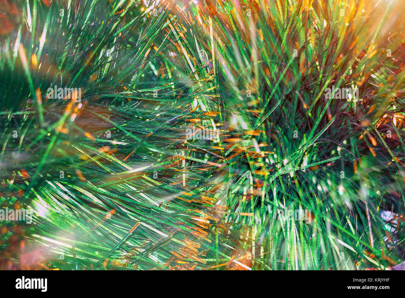 Christmas background of green tinsel - Stock Image