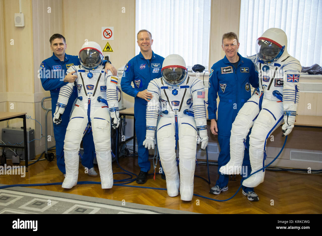 Soyuz TMA-19M crew members with their space suits - Stock Image