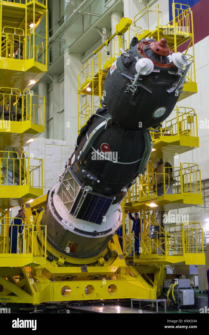 At the Integration Facility at the Baikonur Cosmodrome in Kazakhstan, the Soyuz TMA-19M spacecraft was rotated into - Stock Image