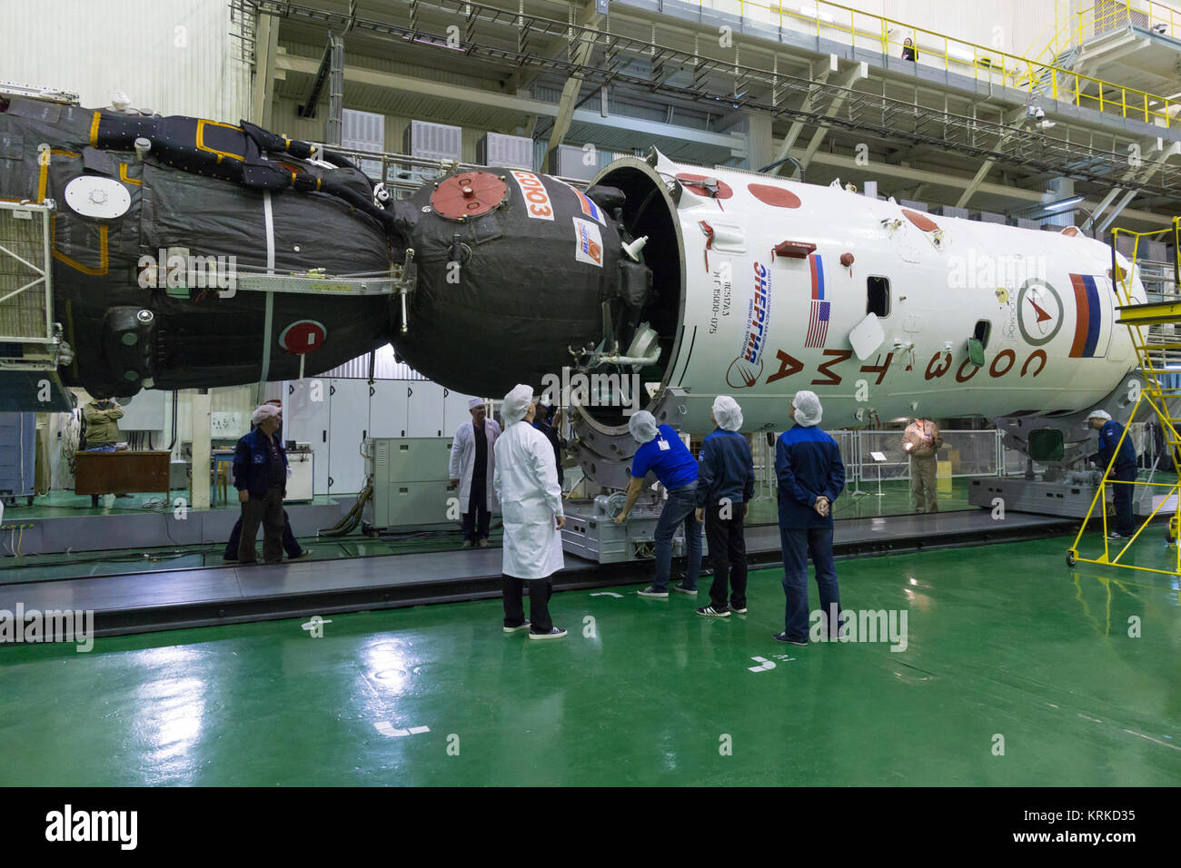 At the Integration Facility at the Baikonur Cosmodrome in Kazakhstan, RSC-Energia technicians look on as the Soyuz - Stock Image