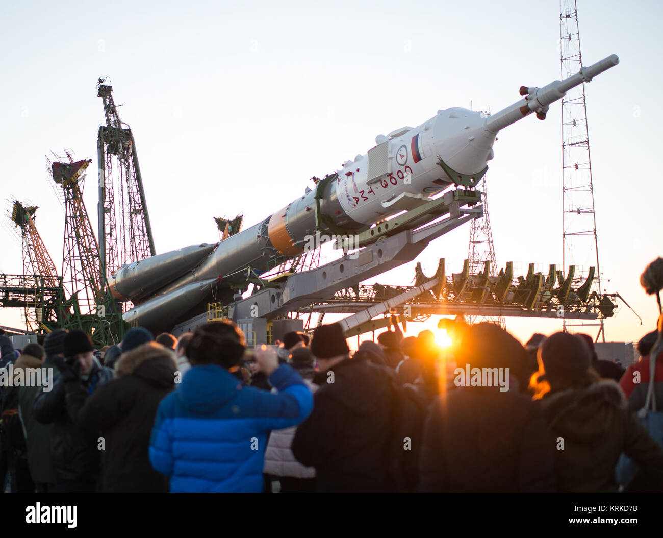 The Soyuz TMA-19M spacecraft is seen as it is raised into a vertical position on the launch pad at the Baikonur - Stock Image
