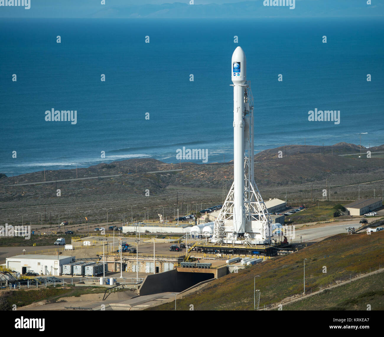 The SpaceX Falcon 9 rocket is seen at Vandenberg Air Force Base Space Launch Complex 4 East with the Jason-3 spacecraft - Stock Image