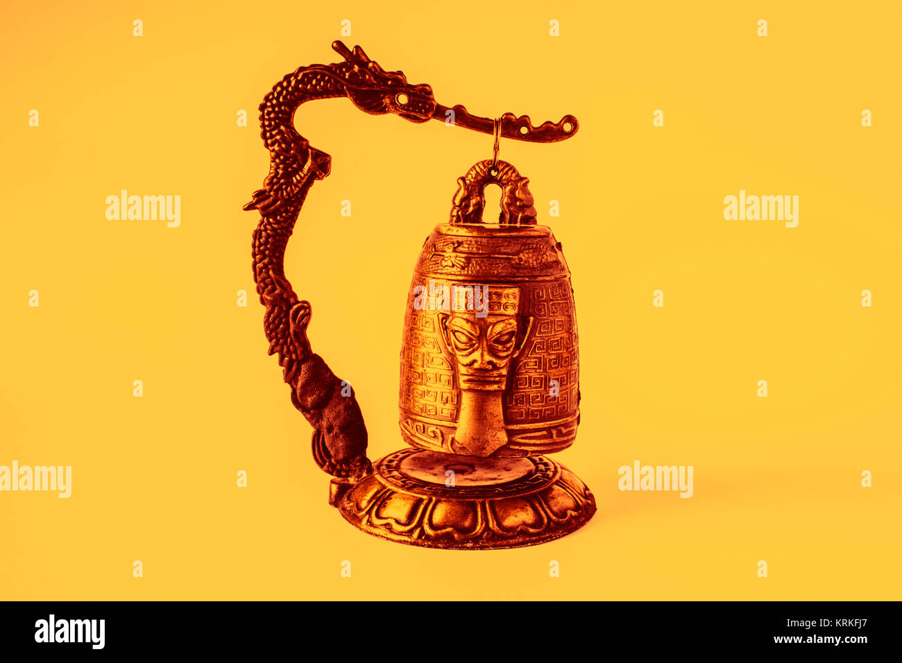 Chinese temple bell small, orange color gleams - Stock Image