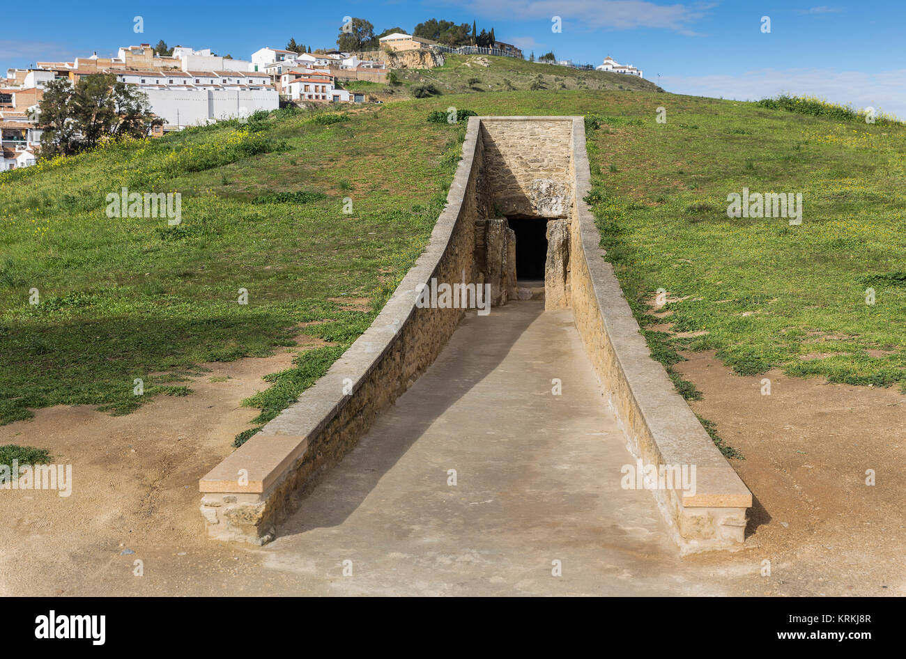 The Dolmen de Viera is in the Spanish town of Antequera (Málaga). Exterior view of the tumulus, and the entrance - Stock Image