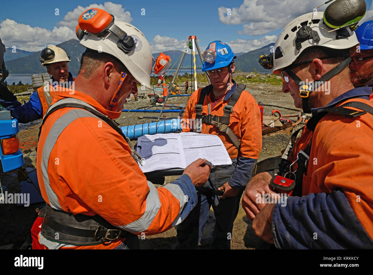 MOANA, NEW ZEALAND, OCTOBER 27, 2017: The safety officer conducts a safety meeting at an abandoned oil well before - Stock Image