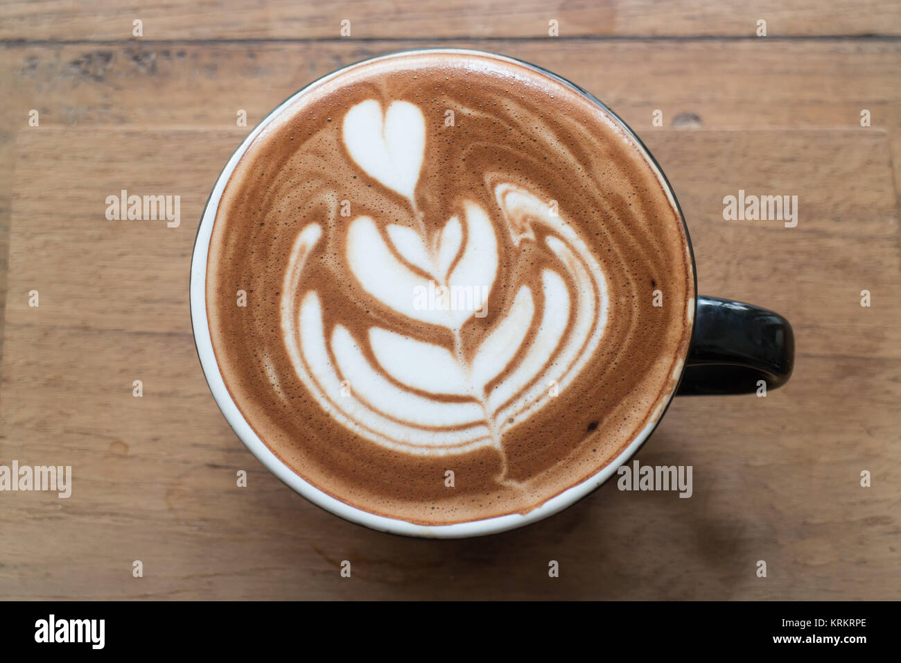 Hot cup of latte art coffee - Stock Image