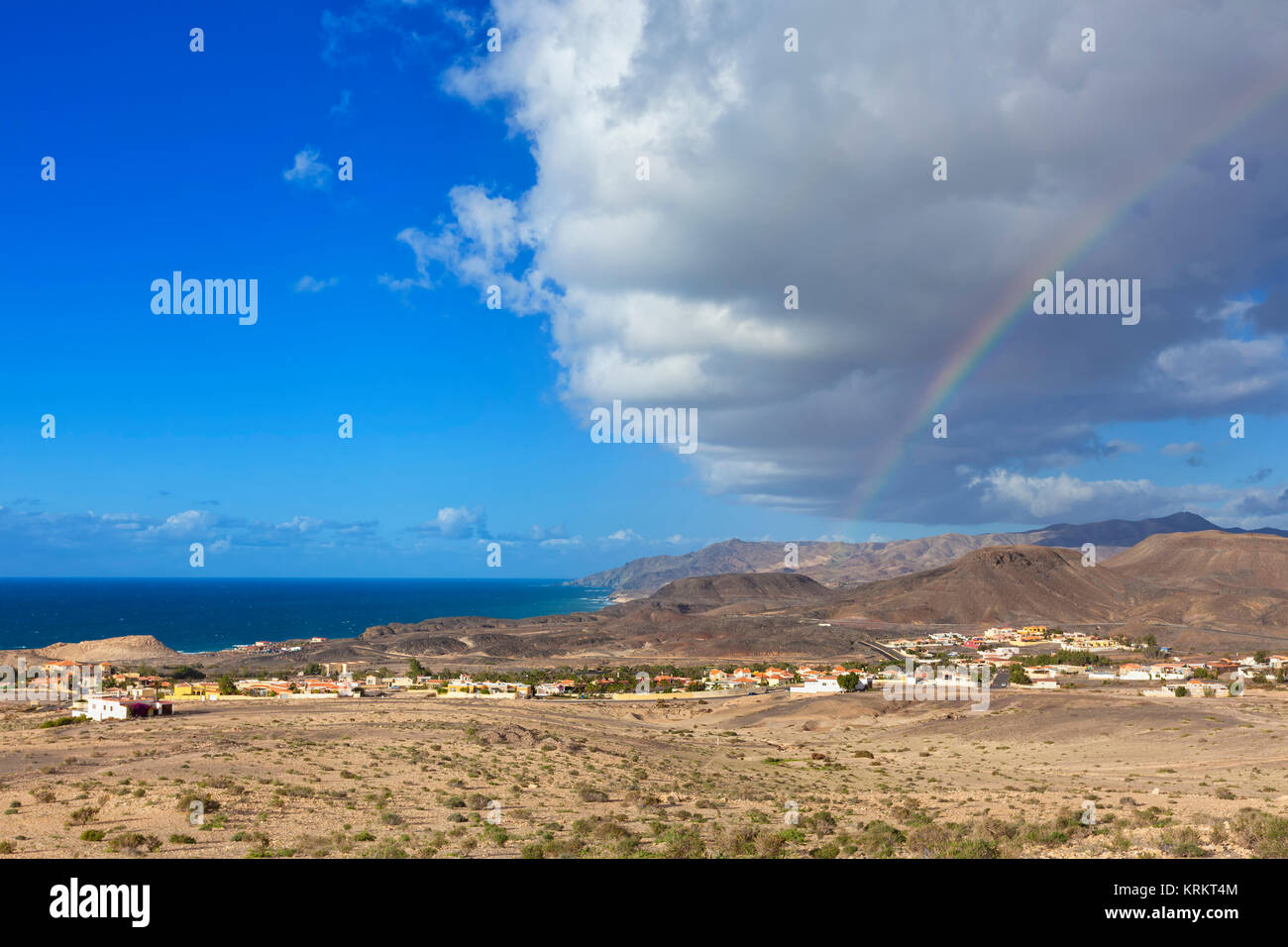 Impressing cloudscape and rainbow above the village of La Pared, Fuerteventura - Stock Image
