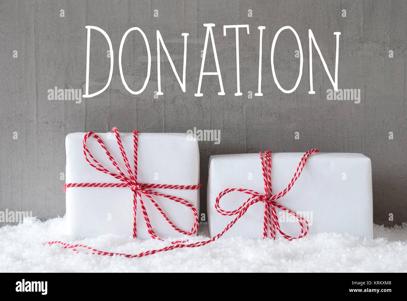 English Text Donation Two White Christmas Gifts Or Presents On Snow Cement Wall As