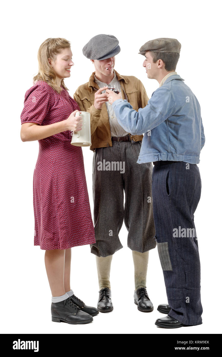 three young people in costumes 40's drink wine Stock Photo