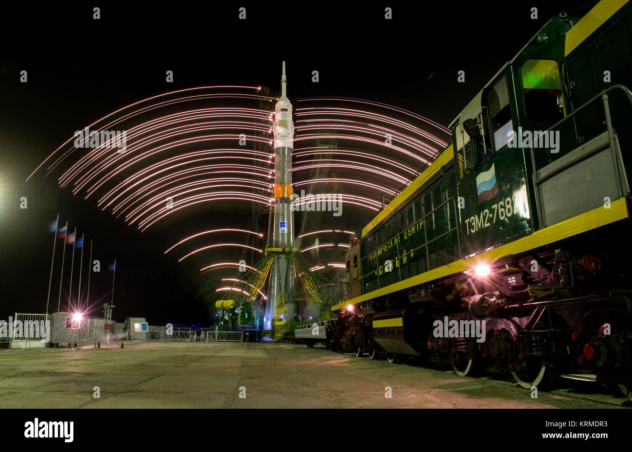 The gantry arms close around the Soyuz TMA-20M spacecraft to secure the rocket, as seen in this long exposure photograph Stock Photo