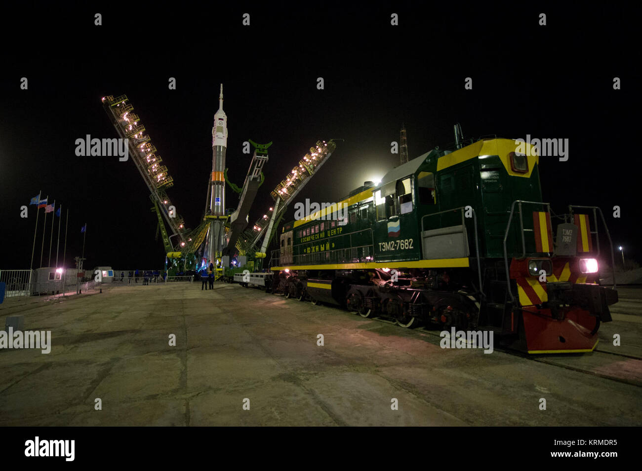 The gantry arms close around the Soyuz TMA-20M spacecraft to secure the rocket at the launch pad on Wednesday, March - Stock Image