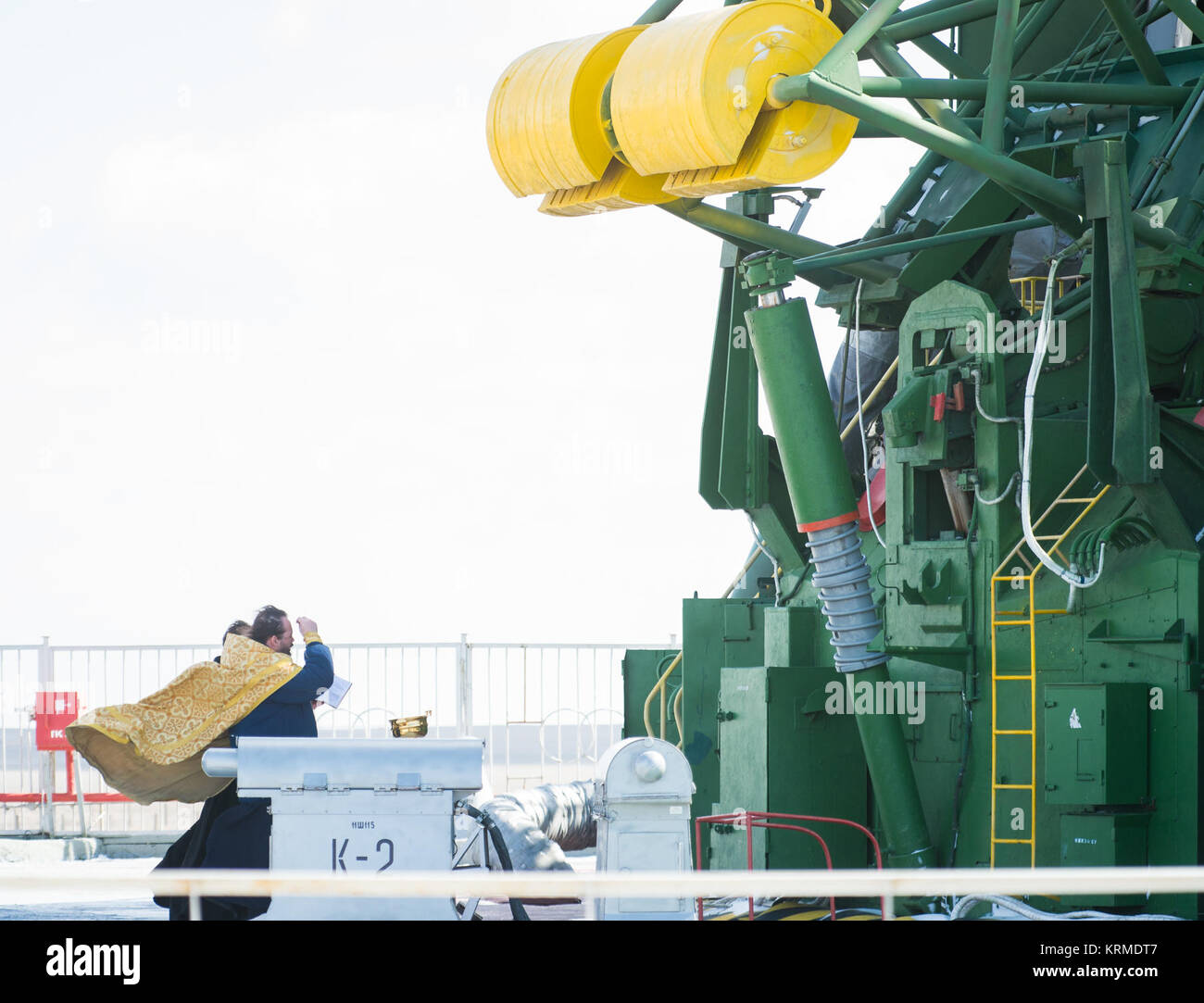 An Orthodox priest blesses the Soyuz rocket at the Baikonur Cosmodrome launch pad on Thursday, March 17, 2016 in Stock Photo