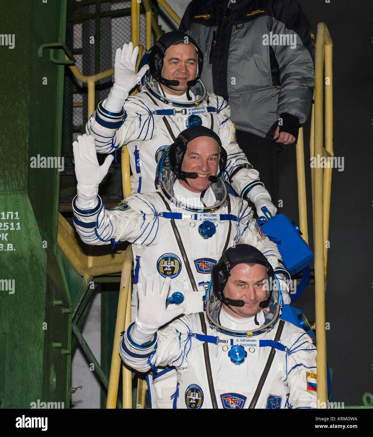 Expedition 47 Soyuz Commander Alexey Ovchinin of Roscosmos, bottom; Flight Engineer Jeff Williams of NASA, center; - Stock Image