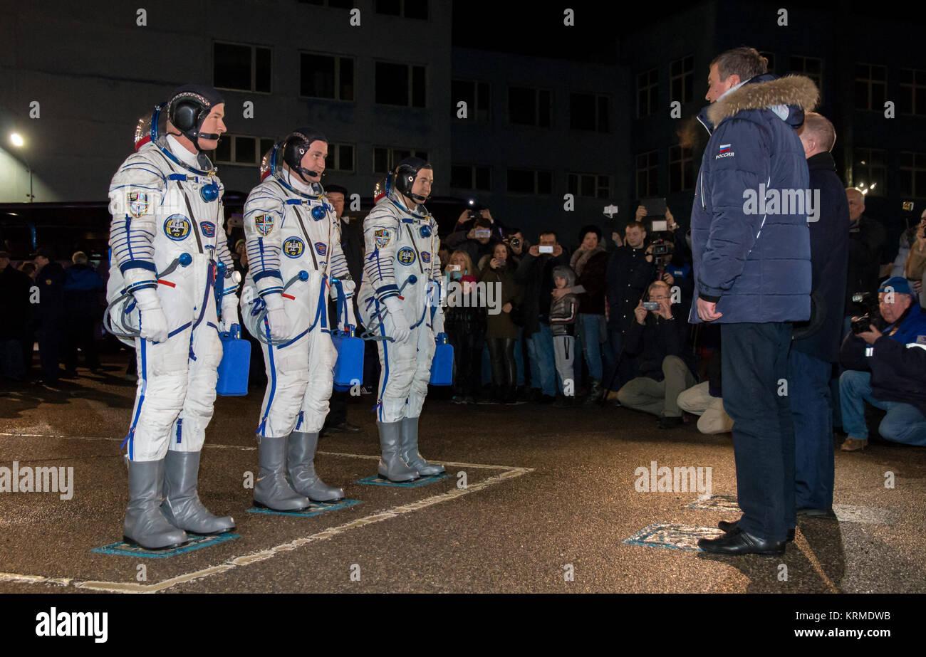 Roscosmos leadership is seen speaking with Expedition 47 Flight Engineer Jeff Williams of NASA, left, Soyuz Commander - Stock Image