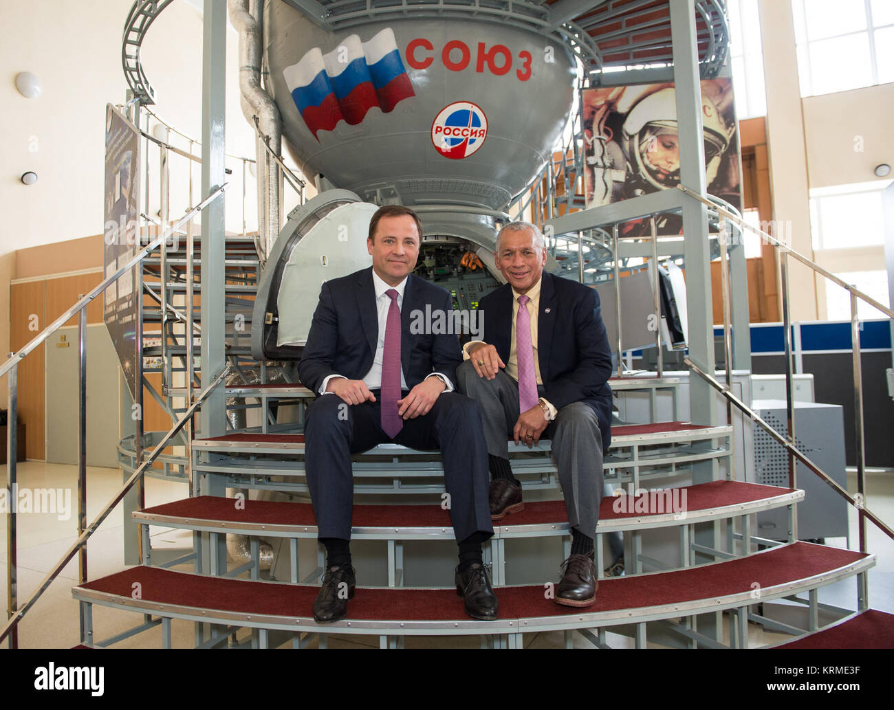 Head of Roscosmos, Igor Komarov, left, poses for a photo in front of a Soyuz spacecraft with NASA Administrator - Stock Image