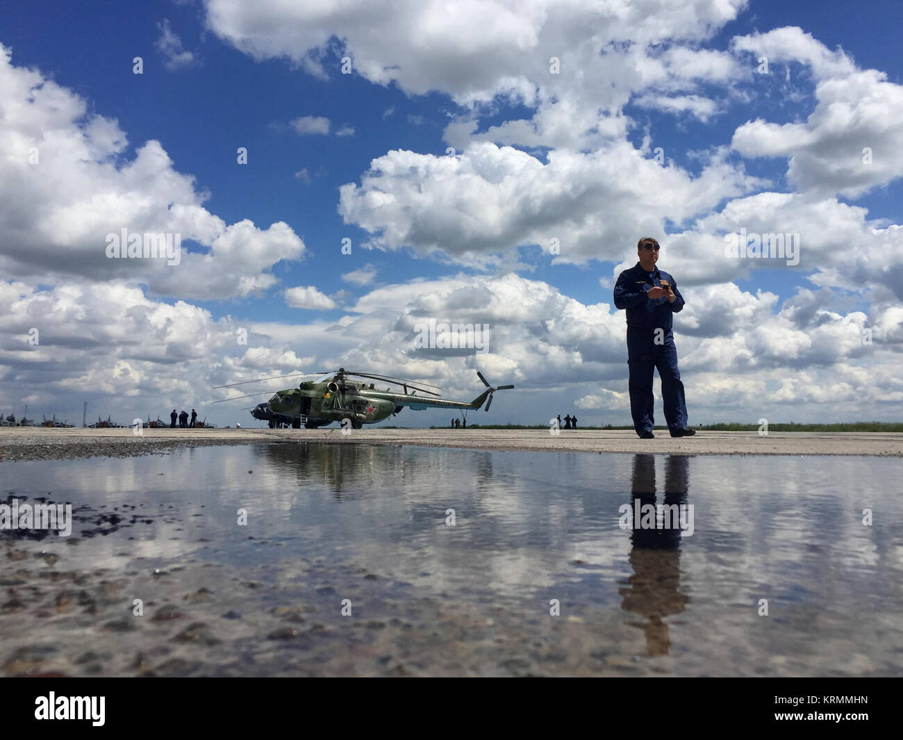 A Russian Search and Rescue MI-8 helicopter crew member waits to depart the Karaganda Airport ahead of the Soyuz - Stock Image