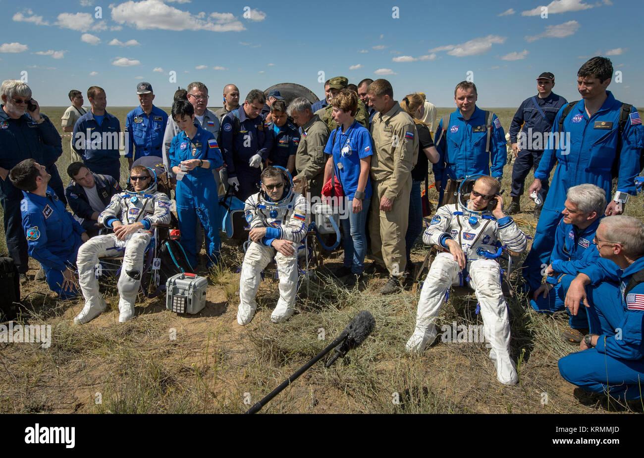 Tim Peake of the European Space Agency, left, Yuri Malenchenko of Roscosmos center, and Tim Kopra of NASA sit in - Stock Image