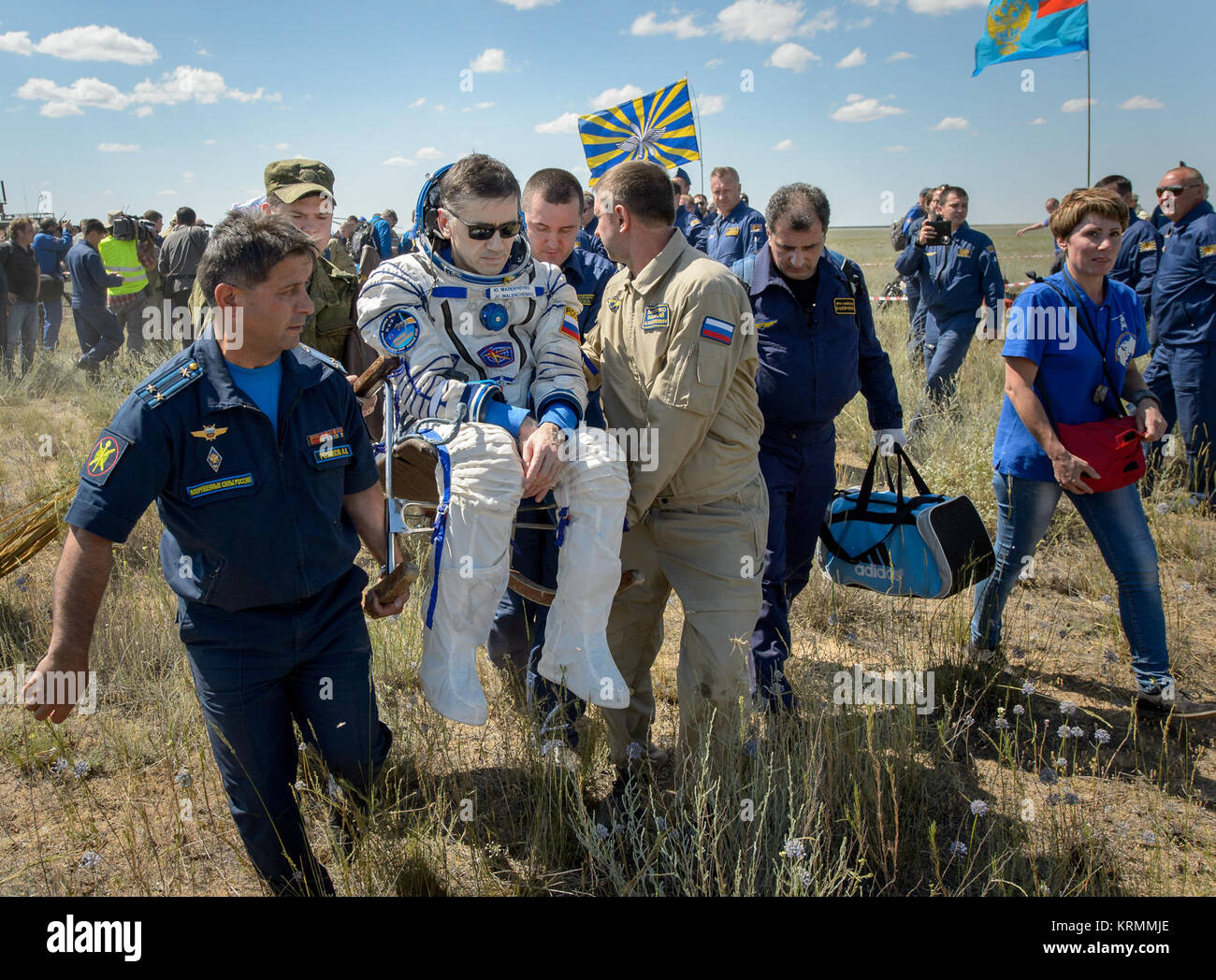 Yuri Malenchenko of Roscosmos is carried to a medical tent after he and Tim Kopra of NASA and Tim Peake of the European - Stock Image