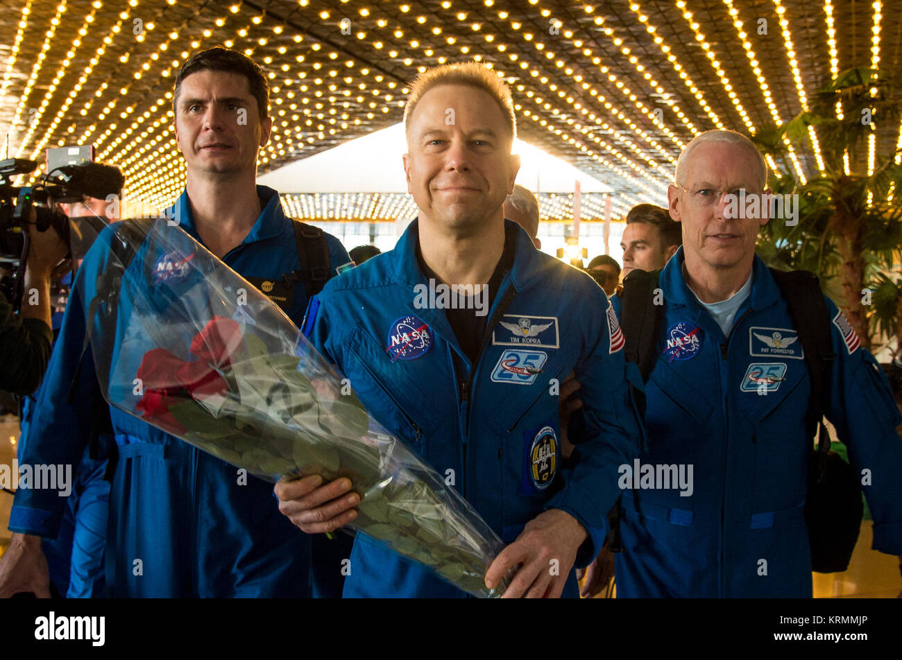 Expedition 47 astronaut Tim Kopra of NASA, center, arrives at the Karaganda Airport in Kazakhstan a few hours after - Stock Image