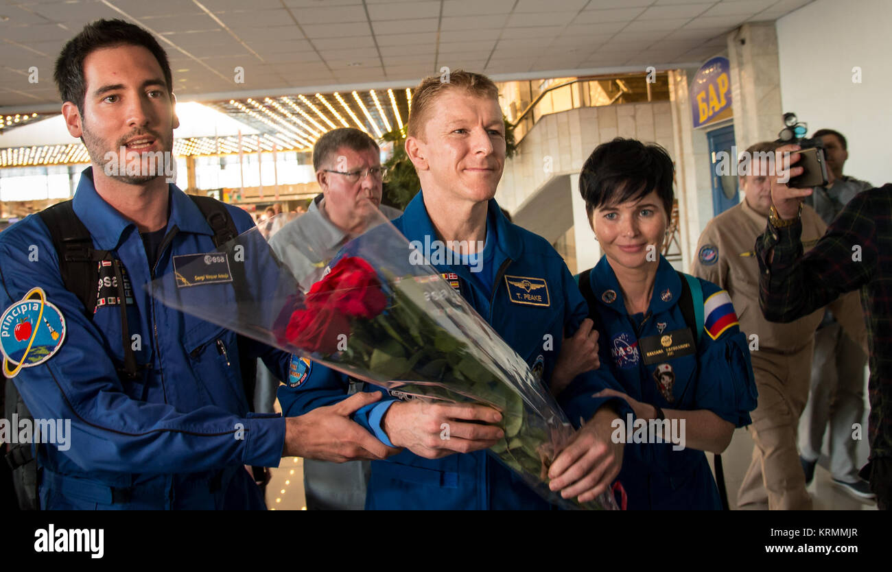 Expedition 47 astronaut Tim Peake of the European Space Agency, center, arrives at the Karaganda Airport in Kazakhstan - Stock Image