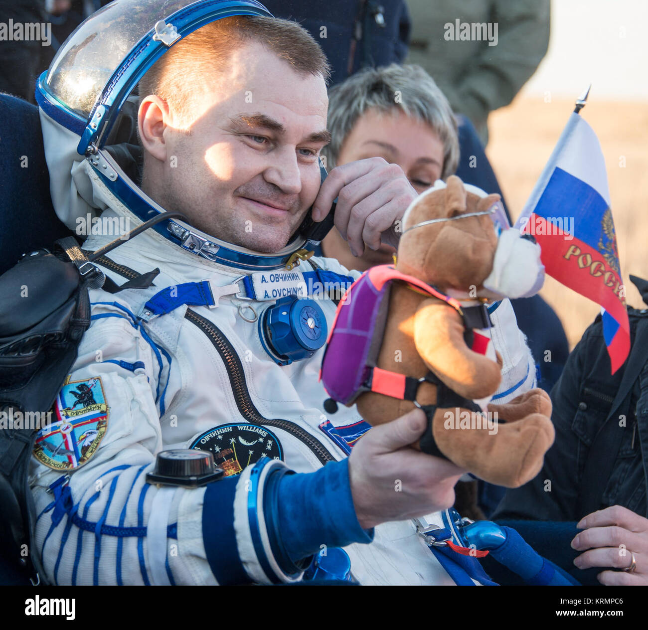 Russian cosmonaut Alexey Ovchinin of Roscosmos rest in  a chair outside the Soyuz TMA-20M spacecraft a few moments - Stock Image