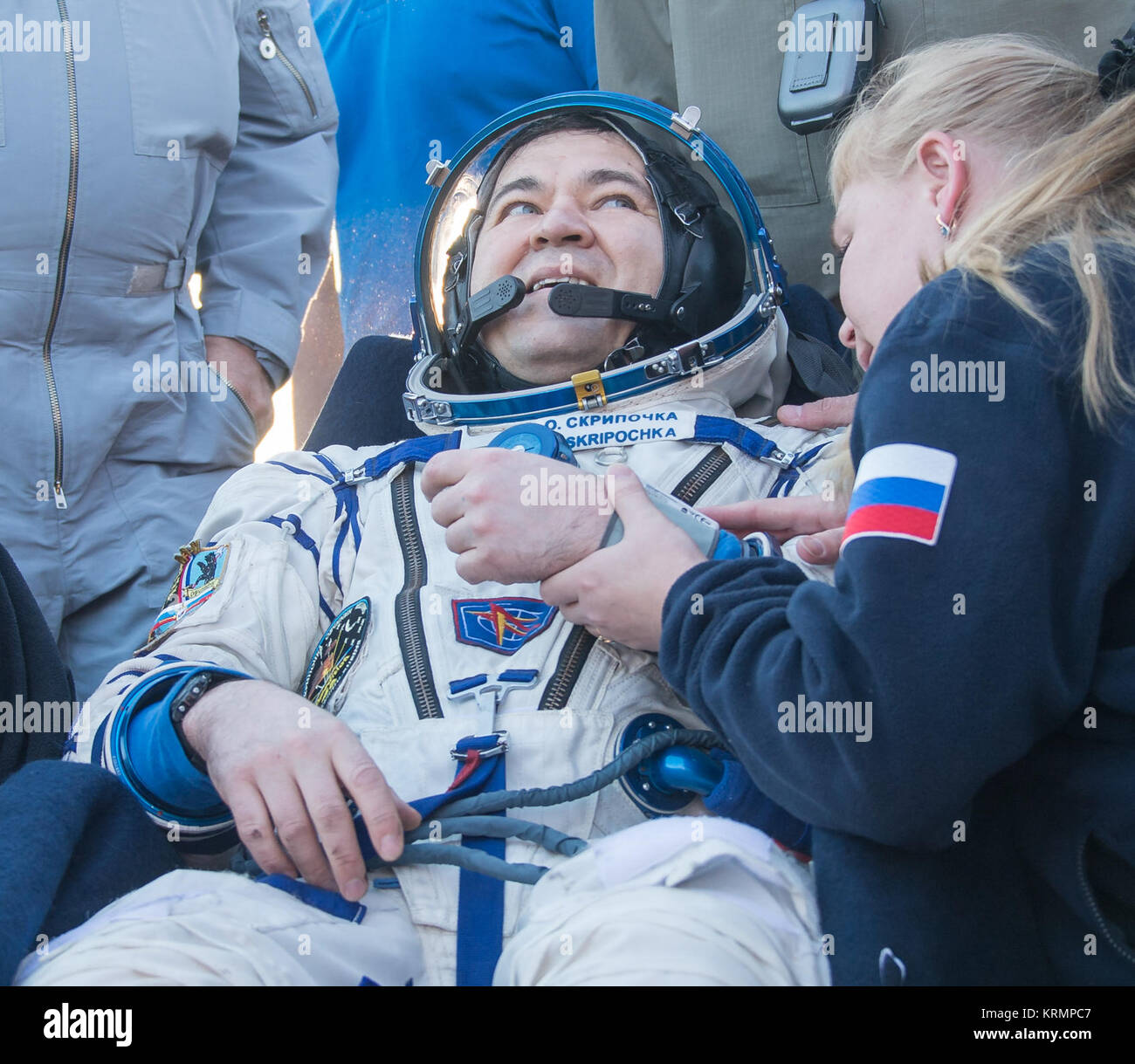 Russian cosmonaut Oleg Skripochka of Roscosmos rest in  a chair outside the Soyuz TMA-20M spacecraft a few moments - Stock Image