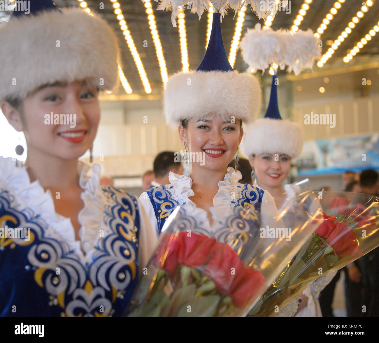 Girls in ceremonial Kazakhstan dress wait to welcome the return of Expedition 48 crew members NASA astronaut Jeff - Stock Image