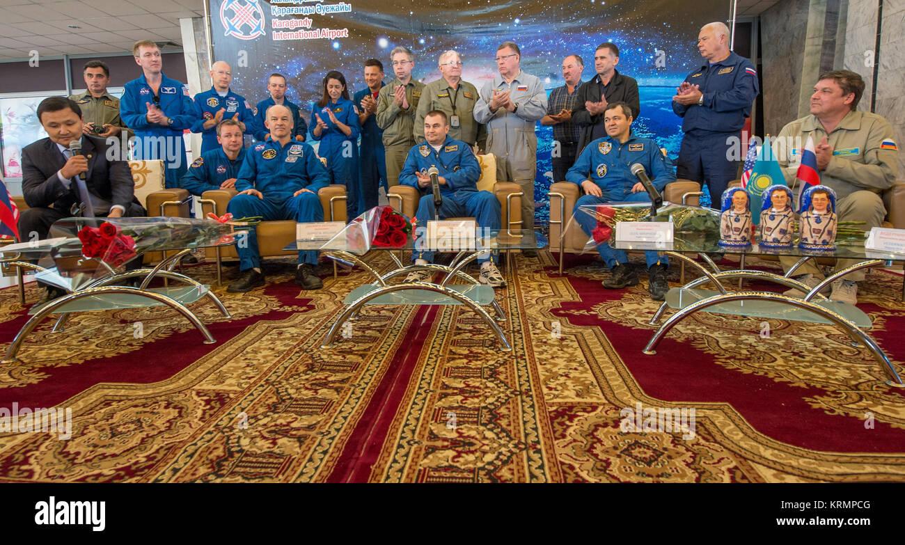Expedition 48 crew members NASA astronaut Jeff Williams, left, Russian cosmonauts Alexey Ovchinin, center, and Oleg - Stock Image
