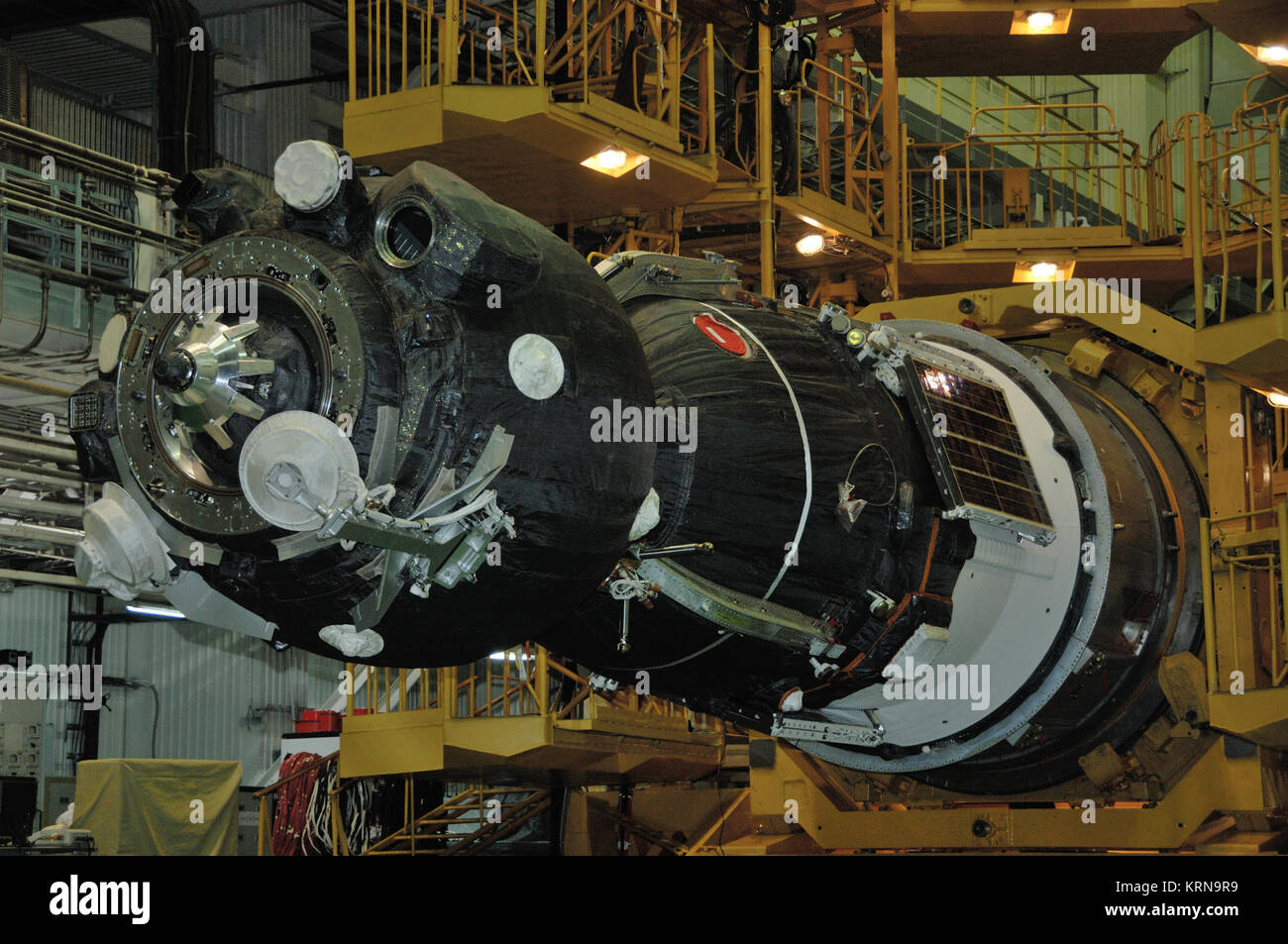 In the Integration Facility at the Baikonur Cosmodrome in Kazakhstan, the Soyuz MS-03 spacecraft sits in its horizontal - Stock Image