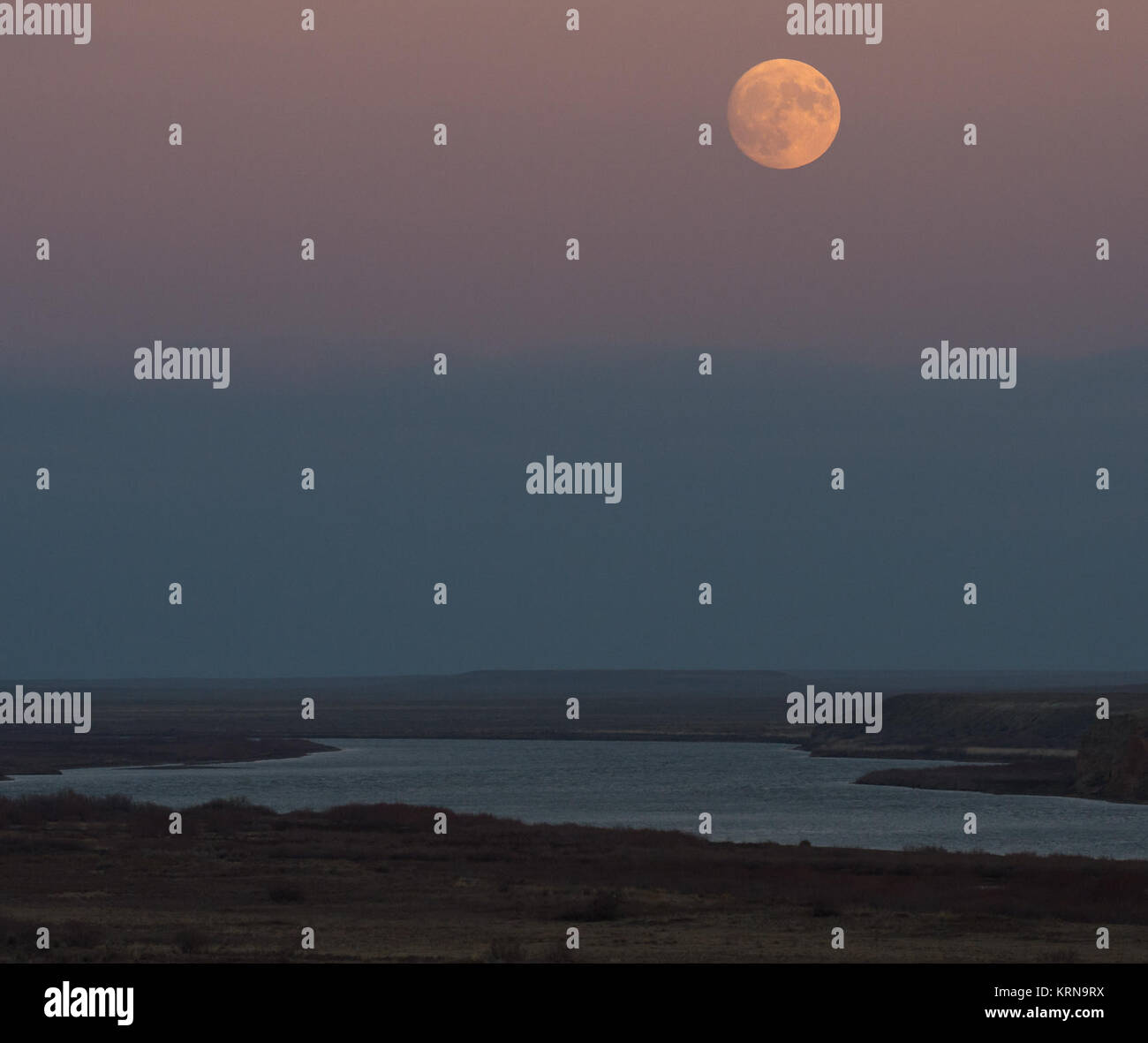 Moonrise over the Syr Darya river, Sunday, Nov. 13, 2016, Baikonur, Kazakhstan. Photo Credit: (NASA/Bill Ingalls) - Stock Image
