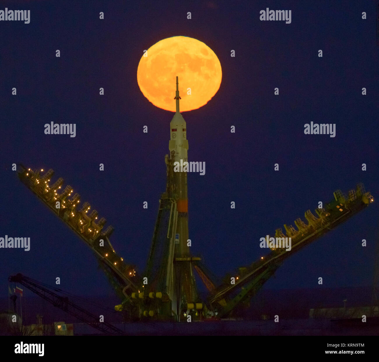 The moon, or supermoon, is seen rising behind the Soyuz rocket at the Baikonur Cosmodrome launch pad in Kazakhstan, - Stock Image