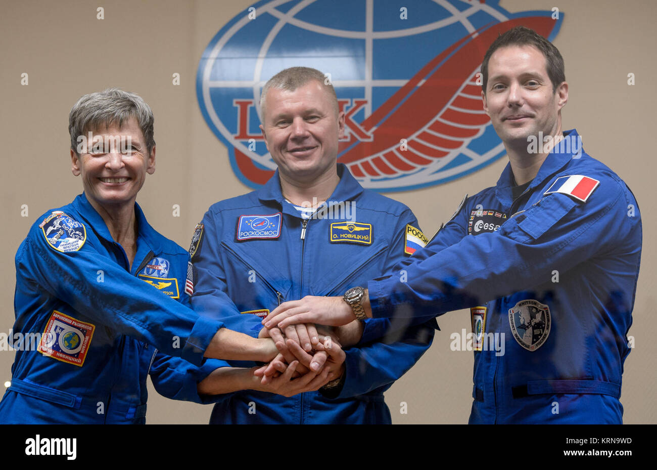 Expedition 50 crew is seen in quarantine behind glass during a crew press conference, from left, NASA astronaut - Stock Image