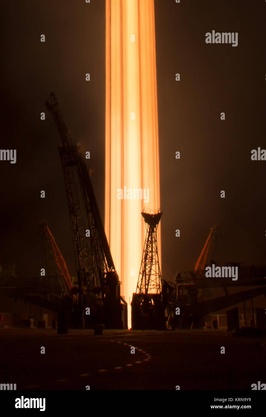 In this long exposure photograph, the Soyuz MS-03 spacecraft is seen launching from the Baikonur Cosmodrome with - Stock Image