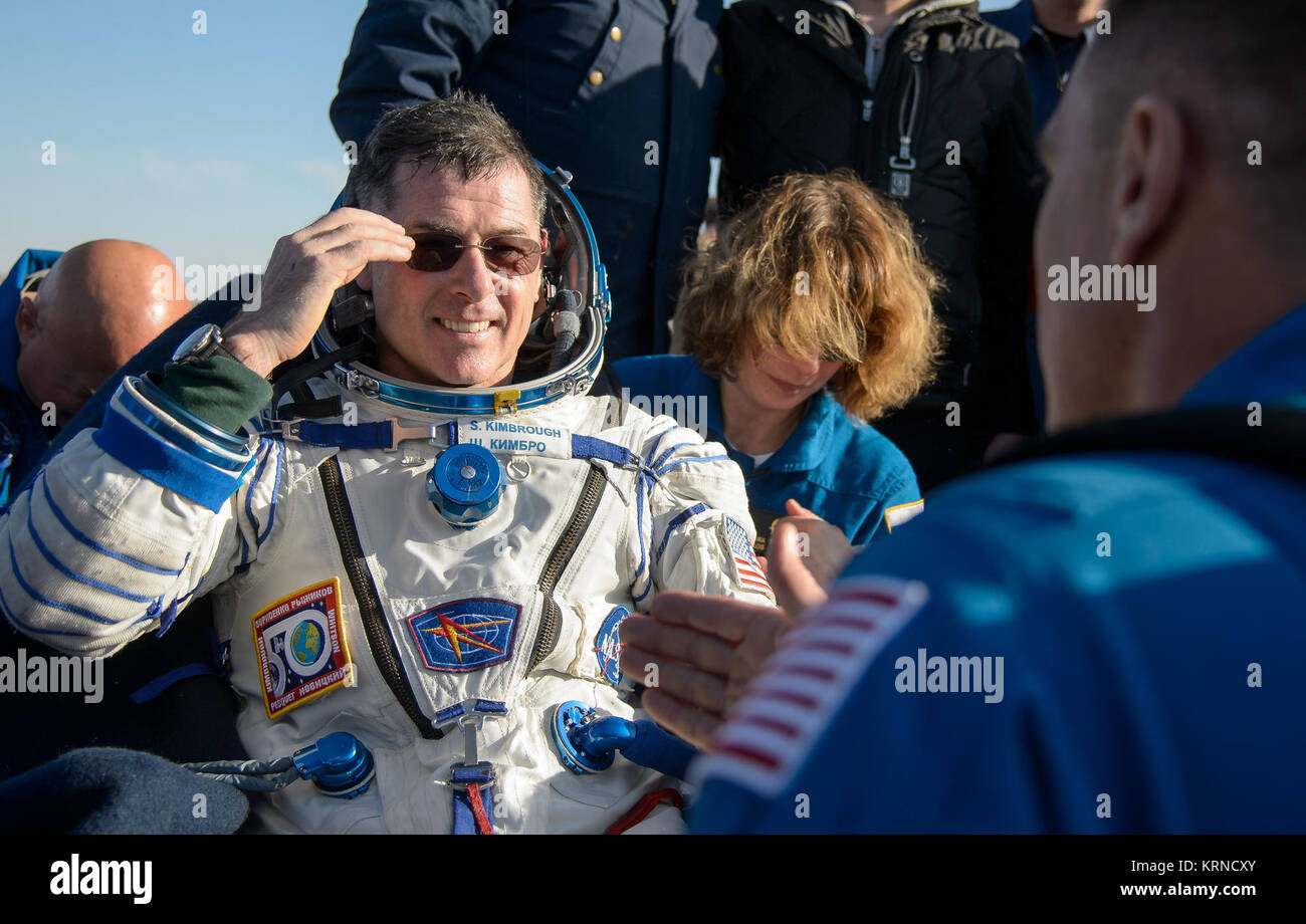 NASA astronaut Shane Kimbrough rests in a chair outside the Soyuz MS-02 spacecraft just minutes after he, Russian - Stock Image