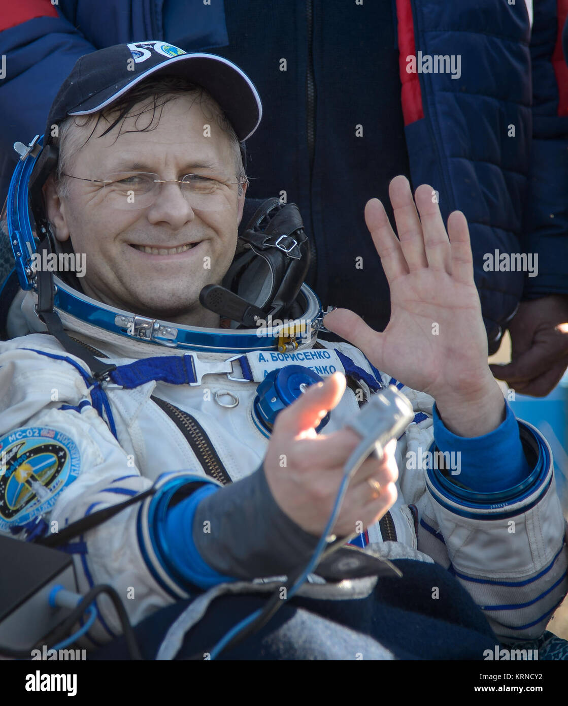 Russian cosmonaut Andrey Borisenko of Roscosmos rests in a chair outside the Soyuz MS-02 spacecraft just minutes - Stock Image