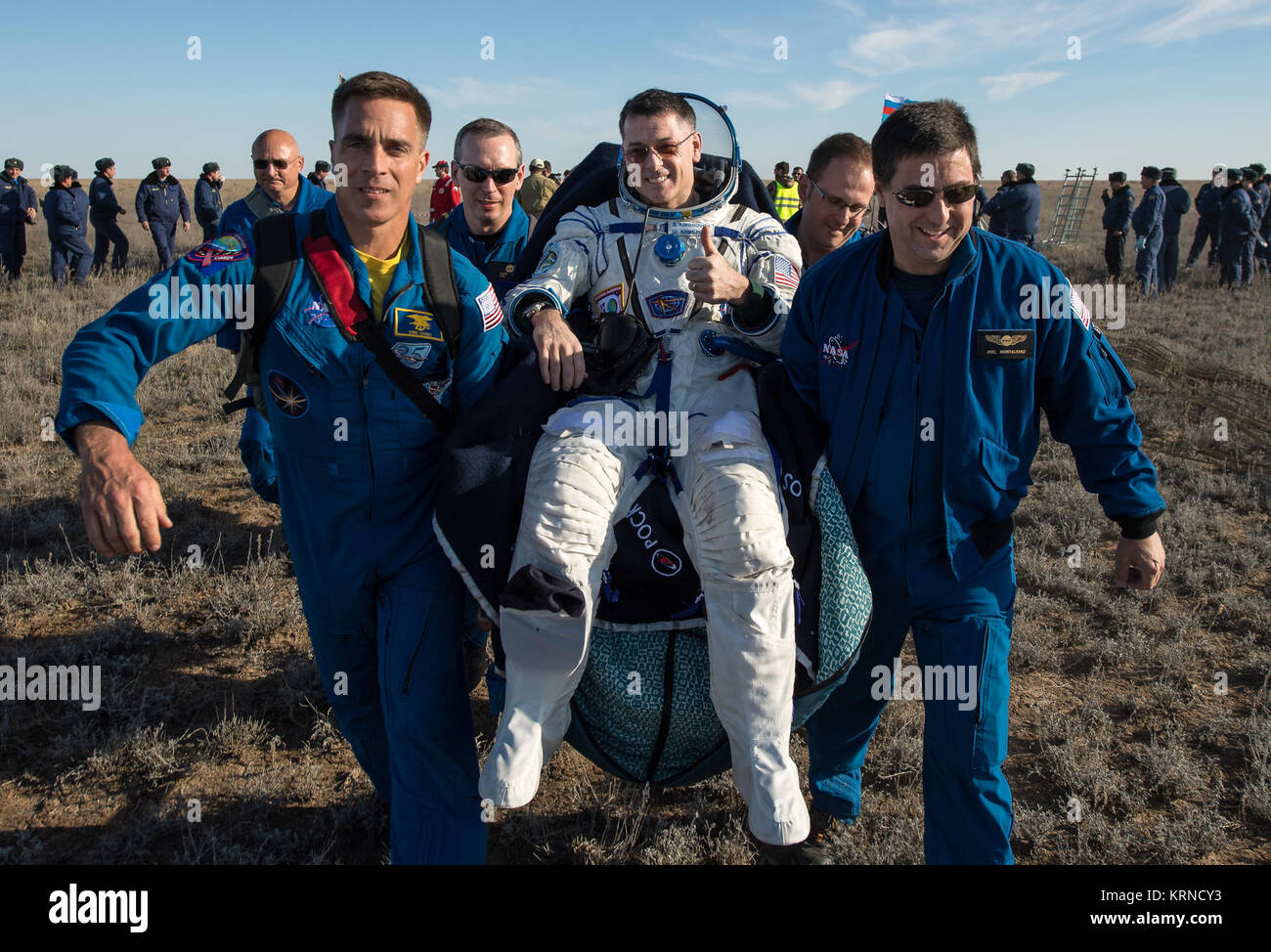 NASA astronaut Shane Kimbrough is carried into a medical tent shortly after he, Russian cosmonaut Sergey Ryzhikov - Stock Image
