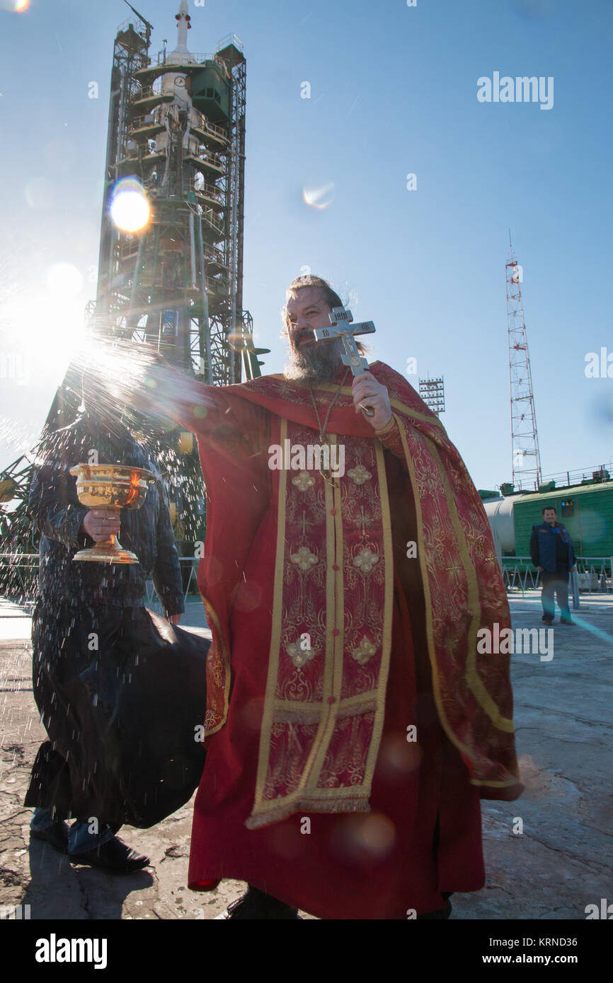 An Orthodox priest blesses the media at the Baikonur Cosmodrome launch pad on Wednesday, April 19, 2017 in Kazakhstan. - Stock Image