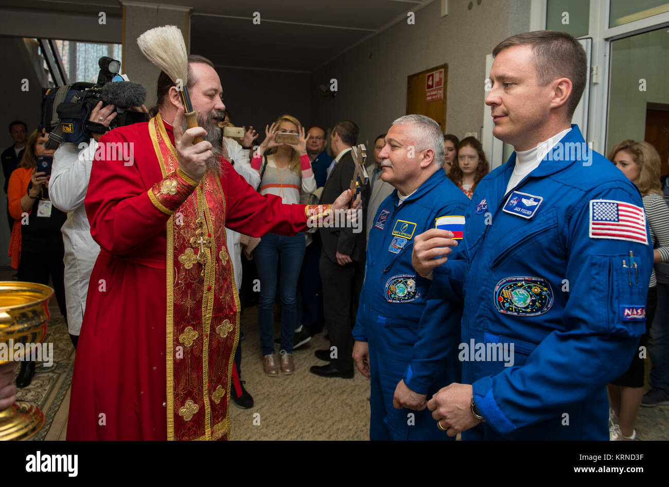 Expedition 51 Soyuz Commander Fyodor Yurchikhin of Roscosmos, left, receives the traditional blessing from a Russian - Stock Image