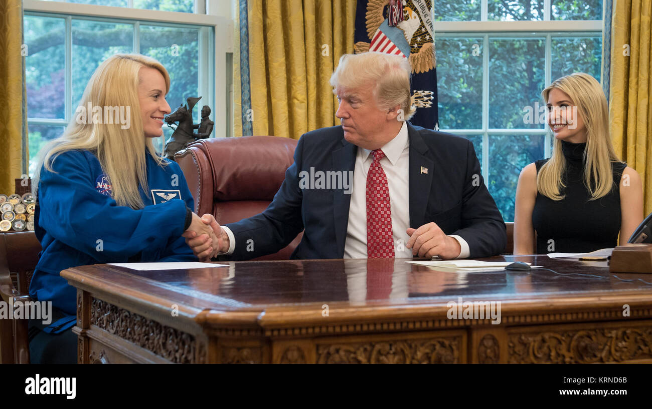 President Donald Trump shakes hands with NASA astronaut Kate Rubins, as First Daughter Ivanka Trump looks on, during Stock Photo