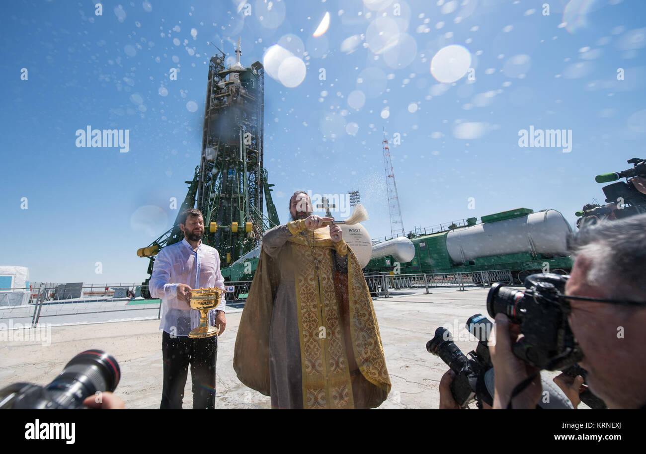 An Orthodox Priest blesses members of the media at the Baikonur Cosmodrome launch pad on Thursday, July 27, 2017. Stock Photo