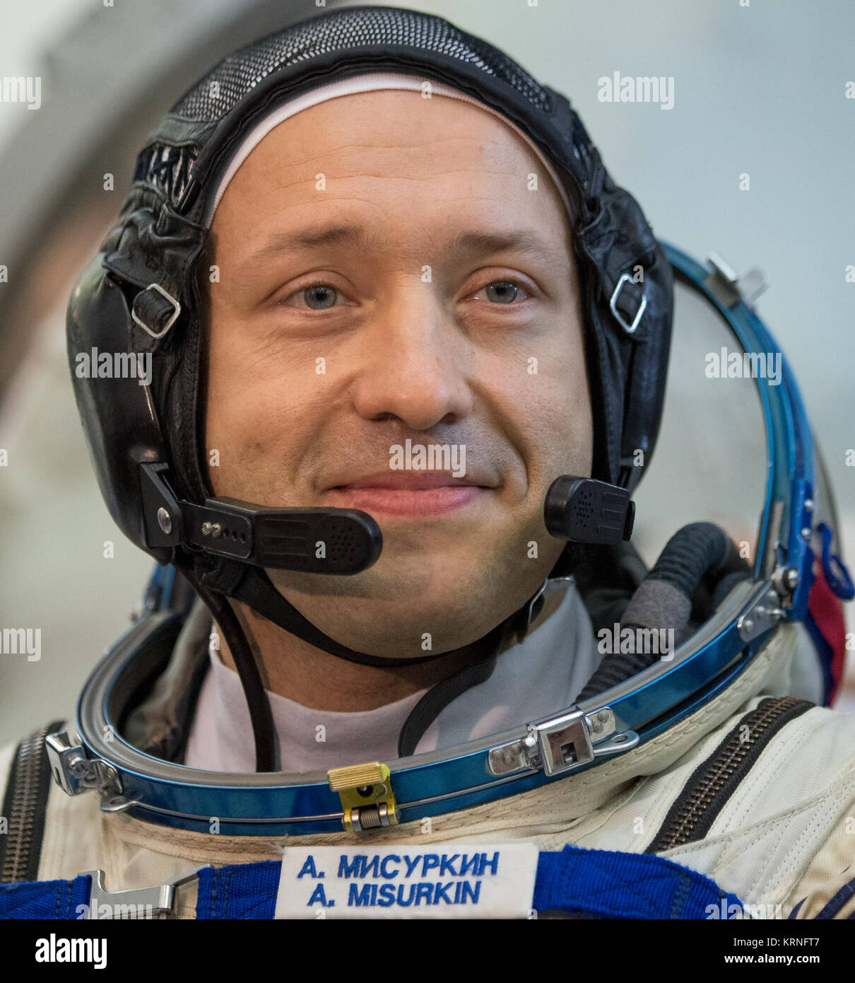 Expedition 53 Soyuz Commander Alexander Misurkin of Roscosmos answers questions from the press outside the Soyuz - Stock Image