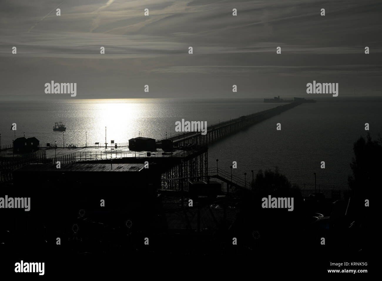 Southend Pier on a foggy misty day making a silhouette of the pier. Stretching out into the mist Thames Estuary, - Stock Image