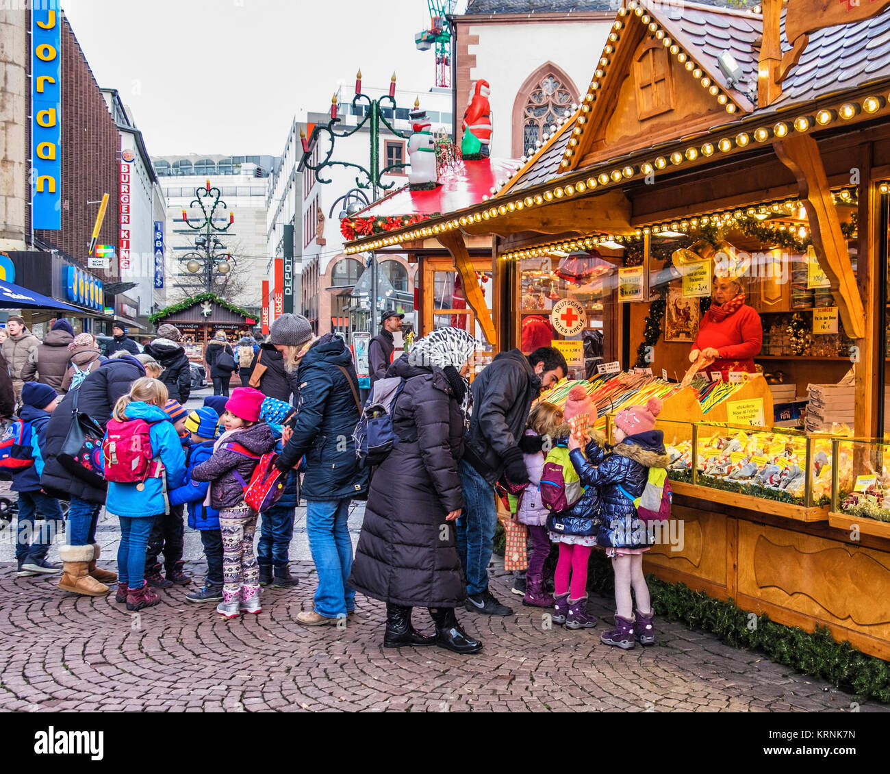 Frankfurt,Germany.Liebfrauenberg. Children shopping at Traditional German Christmas market stall. - Stock Image