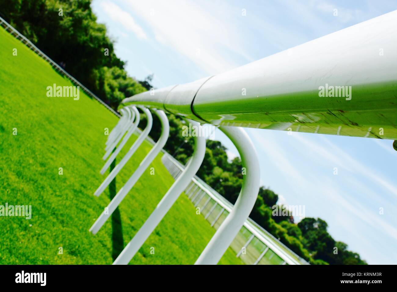White fence at a horse race track - Stock Image