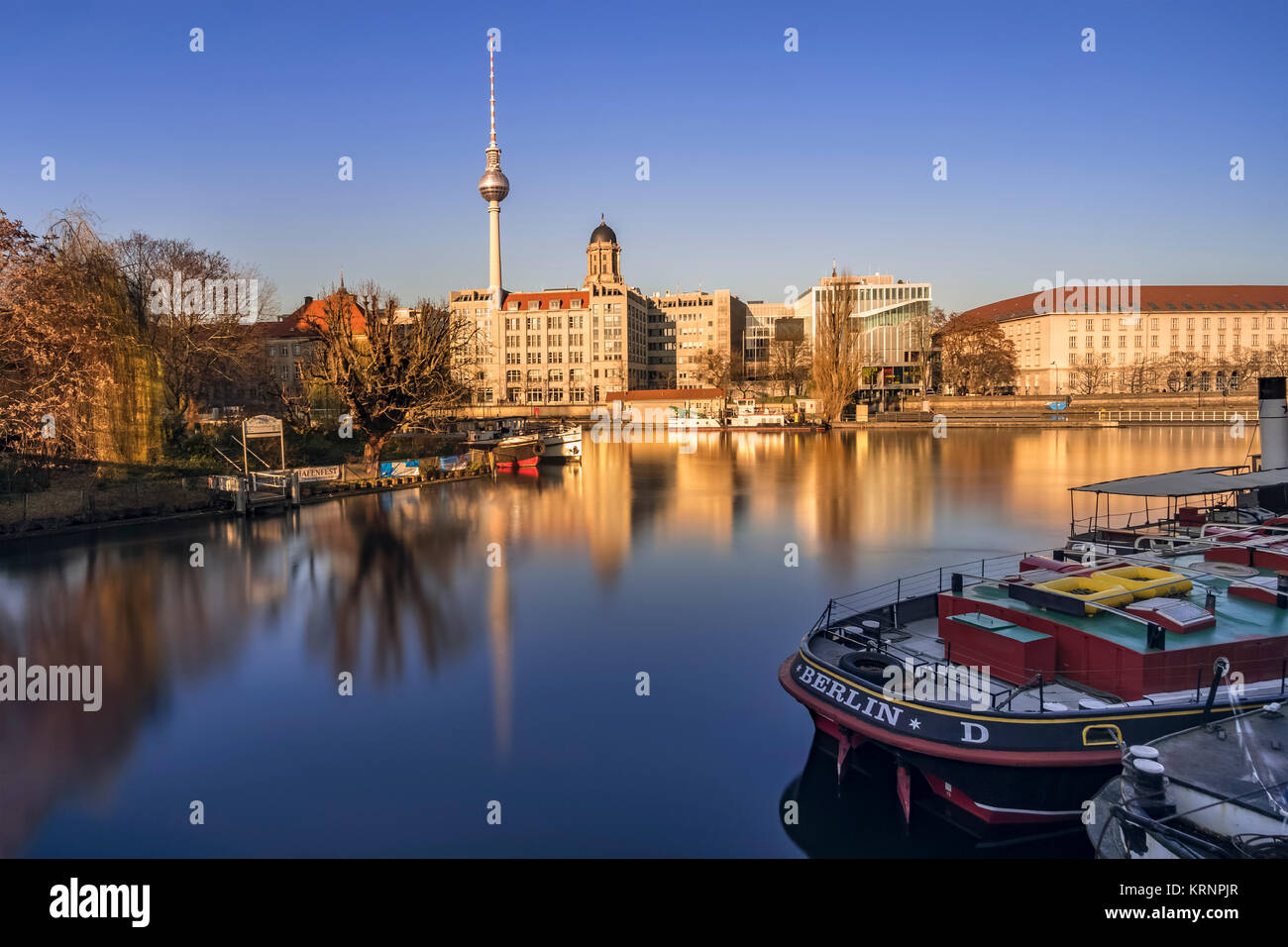 Berlin's historical harbour, TV tower and buildings along the Spree, on a sunny winter afternoon. - Stock Image