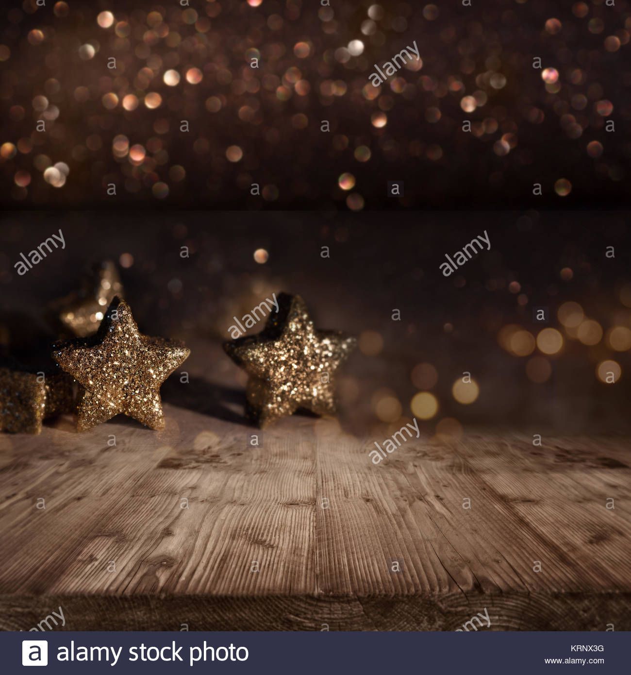 Christmas background with glittering Stars in front of gold shimmering lights Stock Photo