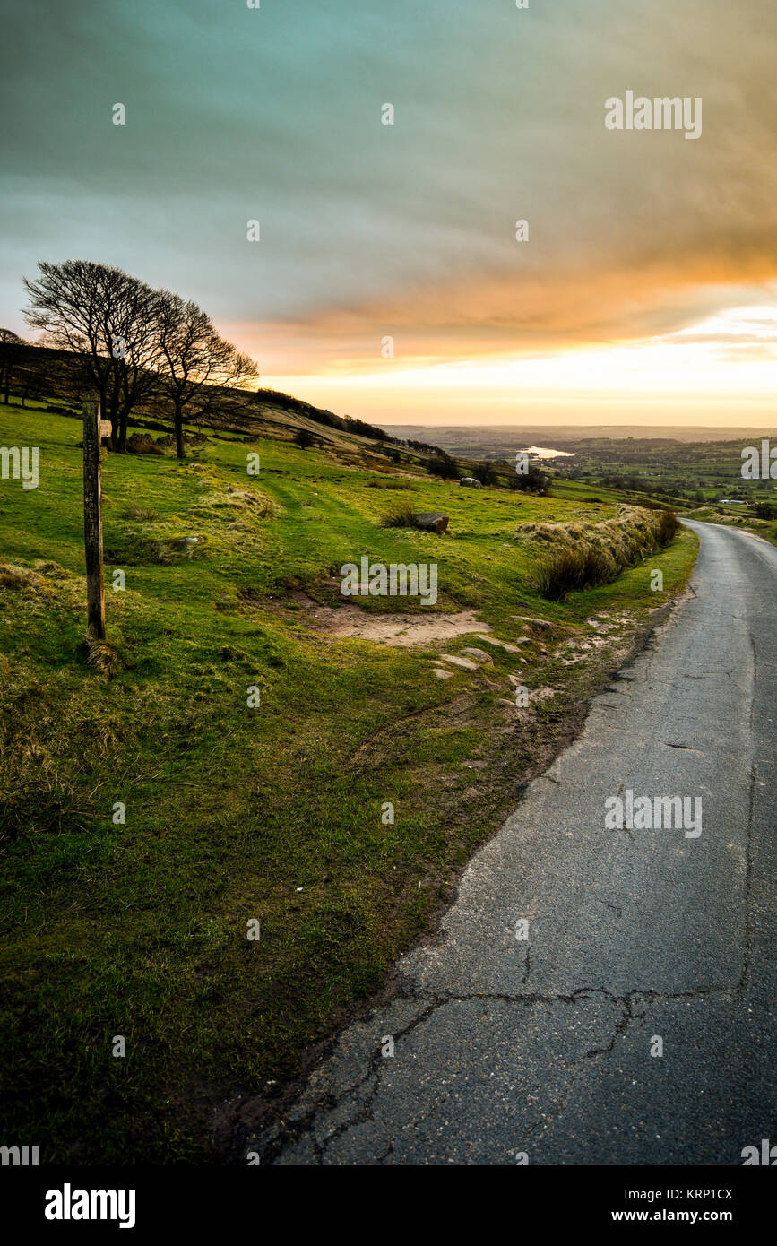 Road and Footpath Sign at Sunset Looking Towards Tittiesworth Reservoir, The Roaches / Hen Cloud Landscape, The - Stock Image