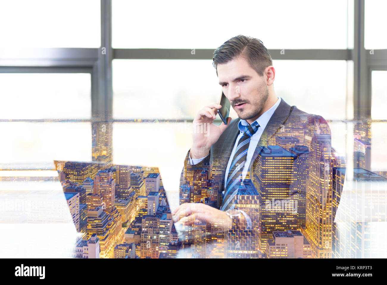 Businessman in office working on laptop computer. - Stock Image