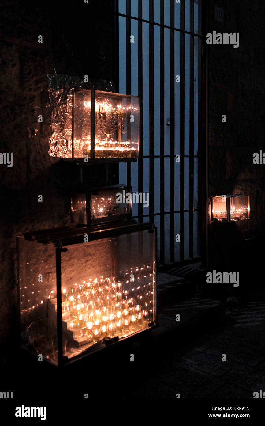 Menorahs burning brightly at the entrance of a house during the Jewish holiday of Hannukah, the festival of lights, - Stock Image