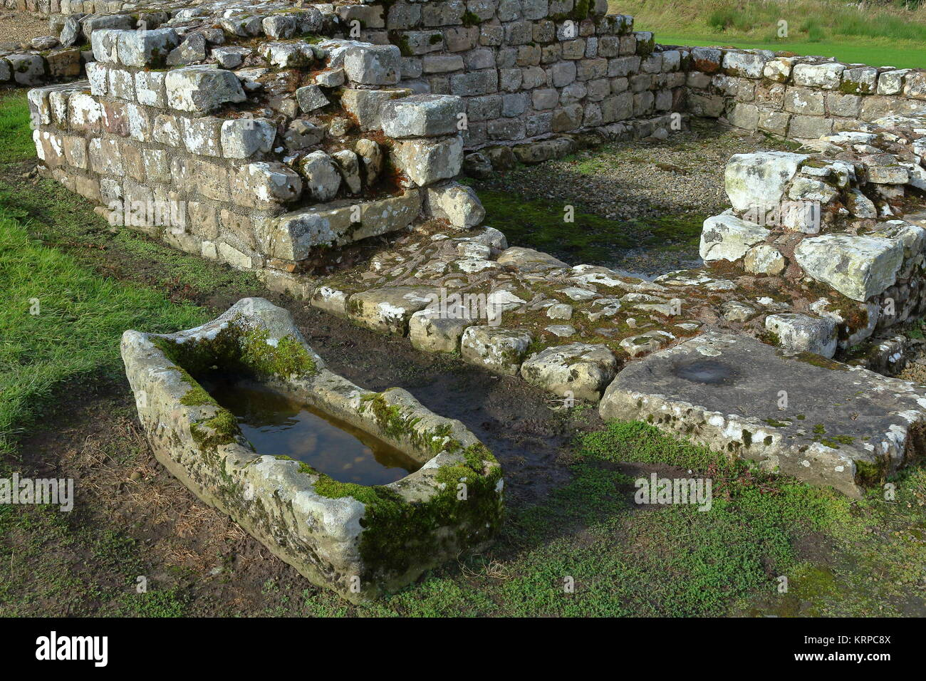 Roman stone trough and ruins at Vindolanda Roman fort, next to Hadrian's Wall, Northumberland. UK. 2017. - Stock Image